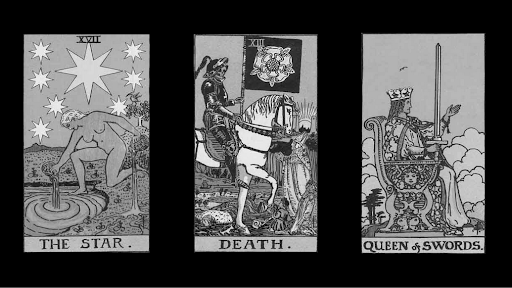 Three cards on top of a black background. The first is The Star, the second Death, and the third is Queen of Swords.